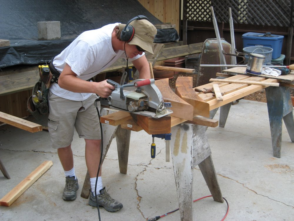 Cutting wood for the custom deck project at our shop