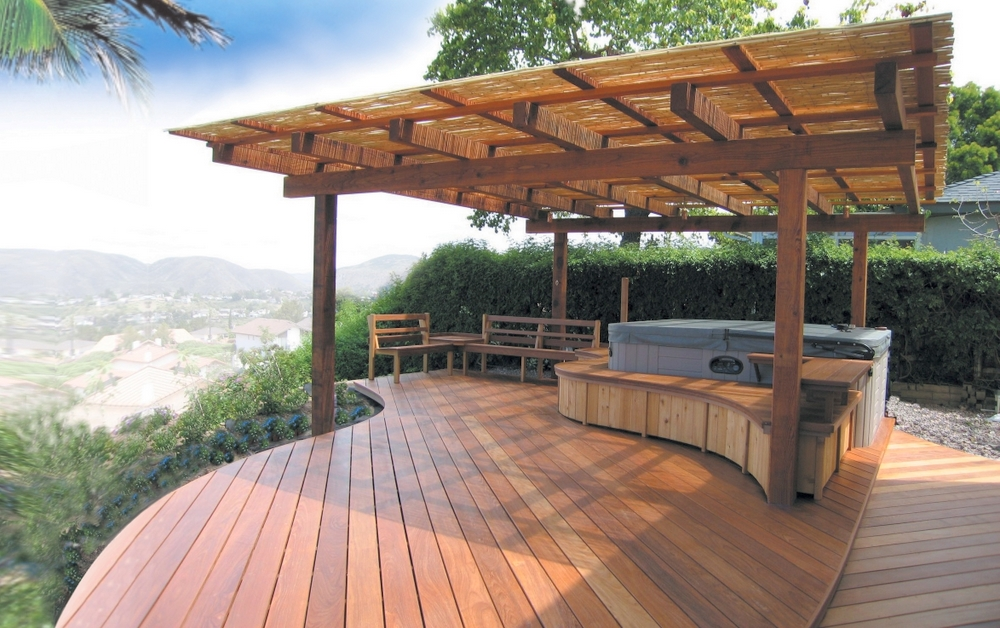A beautiful Ipe deck design with California redwood framed shade cover