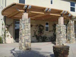 Custom built patio cover with stone columns