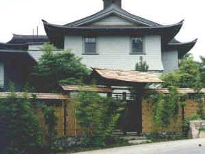 Japanese style draped roof entry gate and fencing