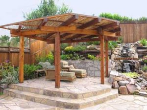 Japanese shade structure built on raised patio in Japanese garden