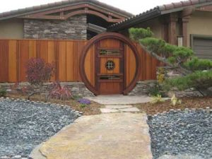 Stunning moon gate entry with Japanese style wide board fence