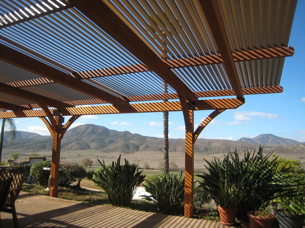 Timber framed patio shade cover with adjustable louvers
