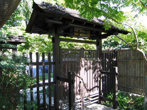 Japanese garden curved roof entry gate